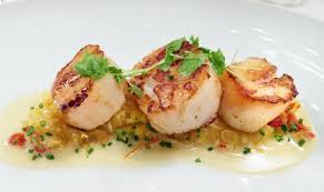 Scallops with White wine and coriander