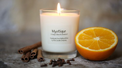warming orange, clove & cinnamon scented candle