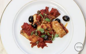 Pollock with tomato & olive sauce served with pasta